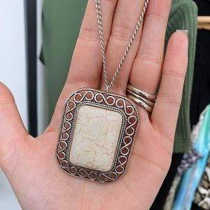 Silver necklace with large sandstone pendant